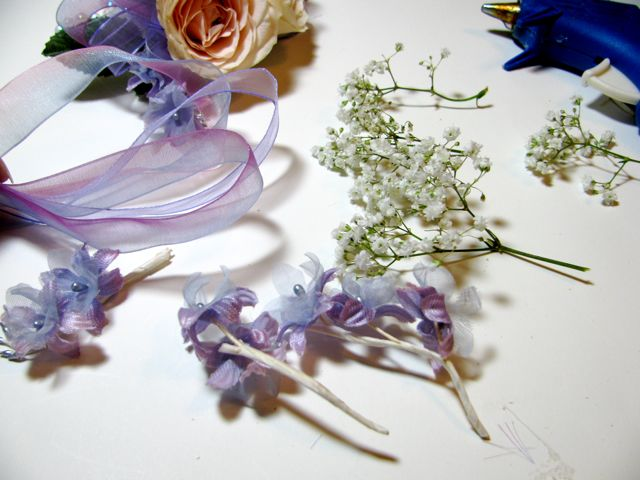Easy wrist corsage tutorial art by debbie saenz cut the babys breath into small sprigs and separate the silk flowers into small clusters set aside corsage 10 mightylinksfo